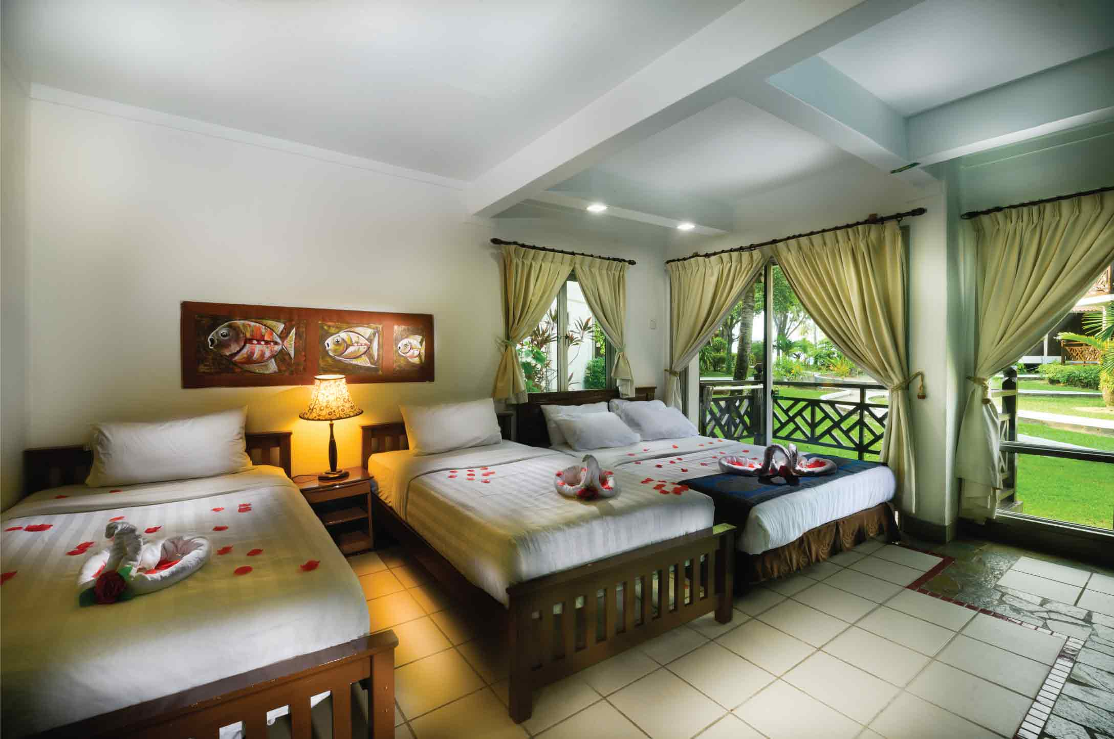 Bedroom With One Queen Sized Bed & Two Single Beds